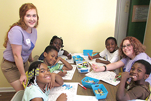 Tutor with children at a summer program