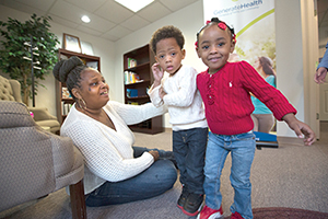 Rose Pernell and children visit Generate Health headquarters.